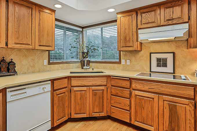 How to Paint Pressed Wood Kitchen Cabinets Like a Pro